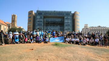 A group of UN staff members in front of the UN House in Beirut