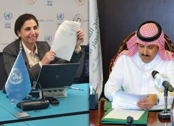 ESCWA Executive Secretary showing signature on agreement, while SDPRY General Supervisor signs on it in a virtual ceremony