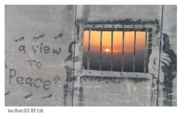 A view to peace, seen from a barred window