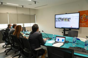 ESCWA ES and team in the virtual meeting facing a giant screen